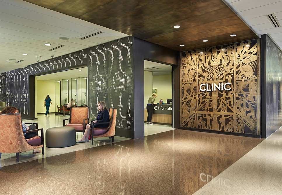 "Shiny surfaces are shown in a rendering of a lobby space, with the word ""Clinic"" on the far wall"
