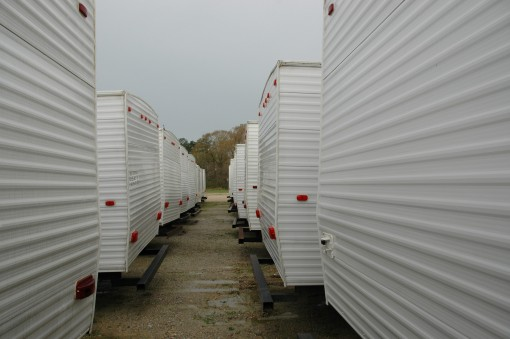 looking through the center of rows of white mobile homes