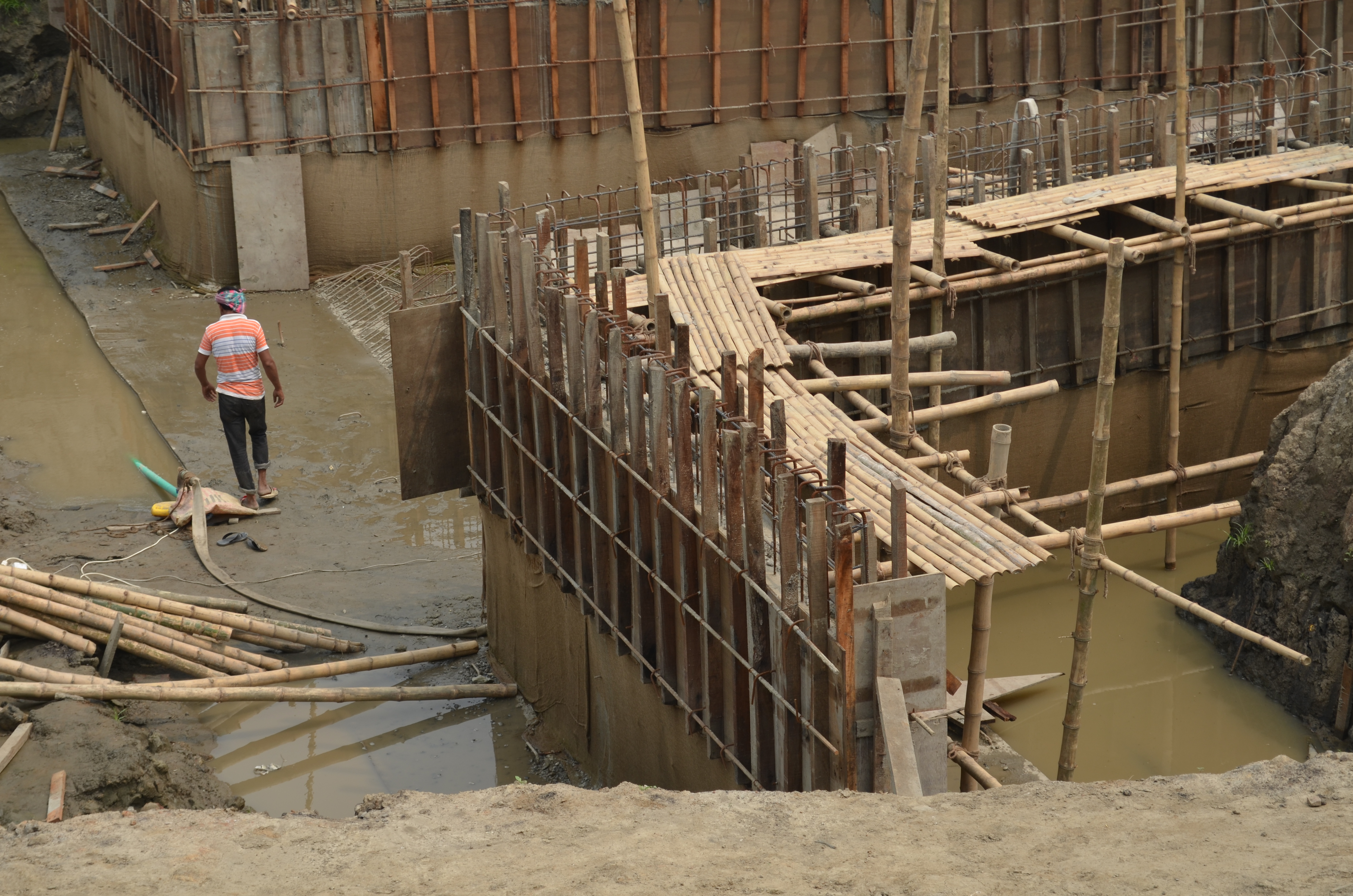 Workers on the site of a new drainage pump station in Dhaka, Bangladesh
